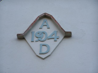 Photograph of date plaque on house reads 1904 AD