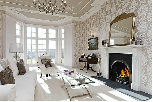 Spacious, bright sitting room with fireplace.