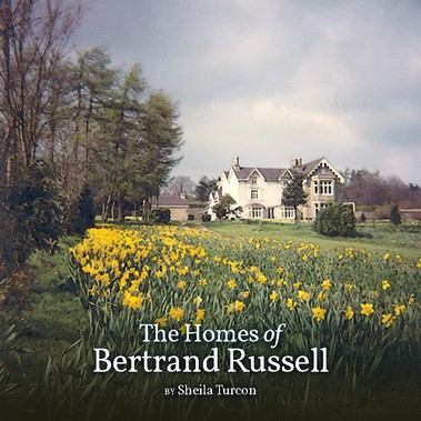 "Image of book cover featuring view of Ravenscroft across field of daffodils, reads ""The Homes of Bertrand Russell"" by Sheila Turcon at bottom"