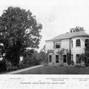 Black and white photograph of large white house at right, left is a large tree. [caption on the image] Pembroke Lodge from the South Lawn.